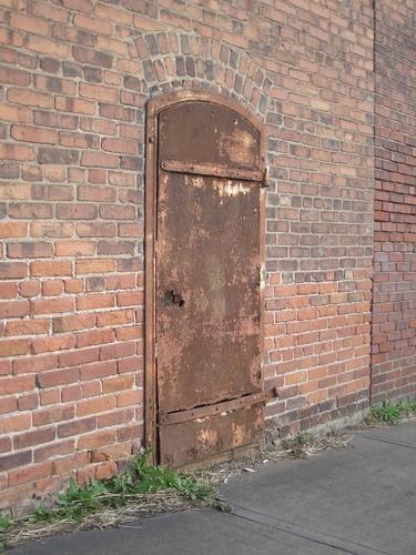 Rusty Metal Door rusty metal door in a brick wall [image 375x500 pixels]